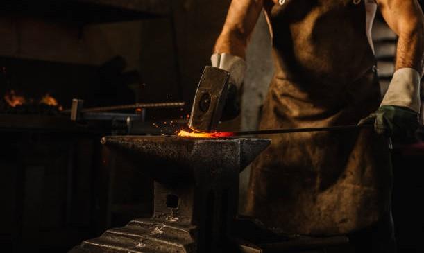 Medieval Blacksmith forging a sword