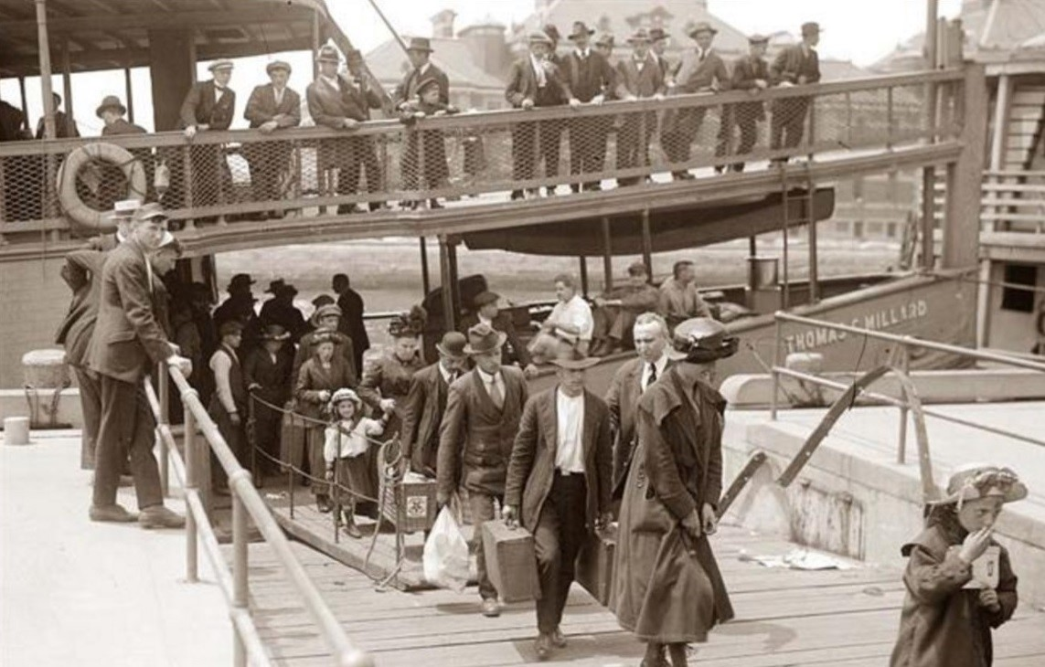 Immigrants landing in Ellis Island all with different surnames and backgrounds